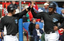 Toronto Blue Jays Vernon Wells, right, and Jeremy Reed celebrate. Wells has struggled with recent injuries.
